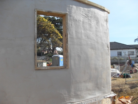 26. Sustainable Building Project - Rendering the Strawbale Walls - Photo 3.JPG